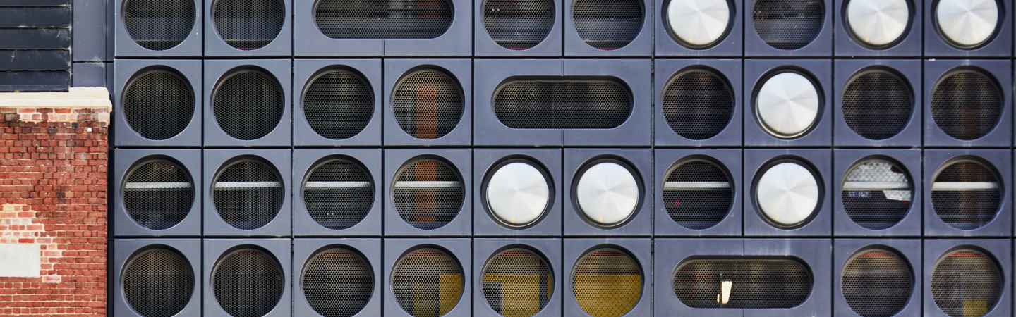 Building with circles on exterior.